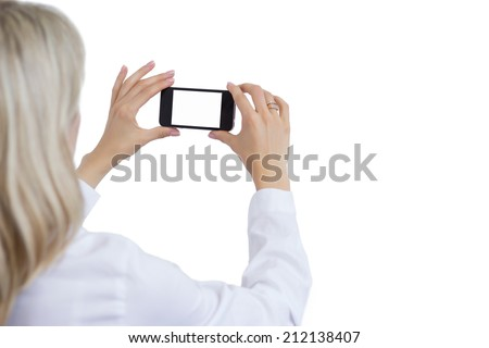 Woman taking photo with mobile phone. Isolated white background for your own image. - stock photo