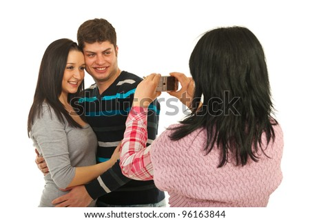 Woman taking photos with phone mobile to her friends couple isolated on white background - stock photo