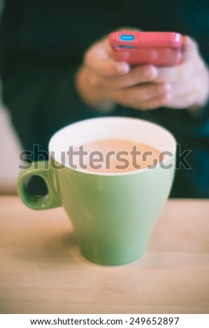 Woman taking picture of meal by smartphone. Vintage retro effect filtered hipster style image. - stock photo
