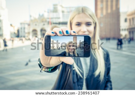 woman taking selfie in saint mark square. concept about travels - stock photo