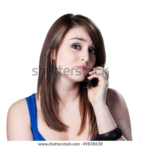 Woman talking on a cell phone - stock photo