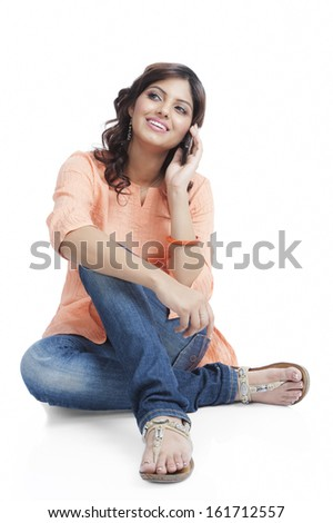 Woman talking on a mobile phone - stock photo