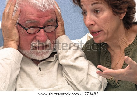 Woman talks at her husband - stock photo