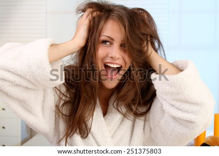 woman tearing her hair - stock photo