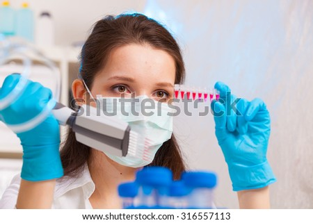woman technician in microbiological laboratory - stock photo