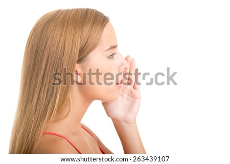Woman telling a secret, isolated in white - stock photo