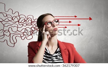 Woman thinking something over - stock photo