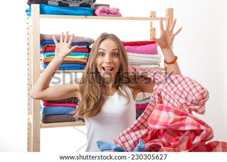 woman throws a pile of clothes, isolated on white background - stock photo