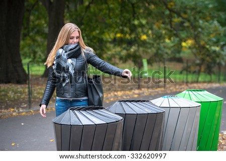 Woman throws recycle paper trash in the trash sorting waste - stock photo