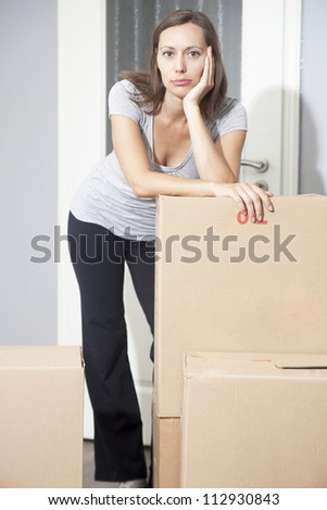 Woman tired of moving house - stock photo