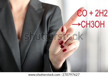 Woman Touching  a chemical formula of methanol - stock photo