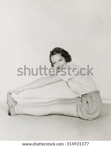 Woman touching her toes - stock photo