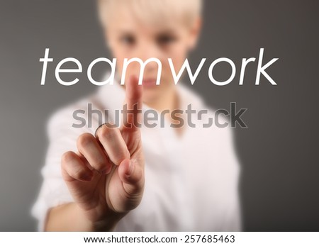 Woman touching sign - Teamwork business concept - stock photo