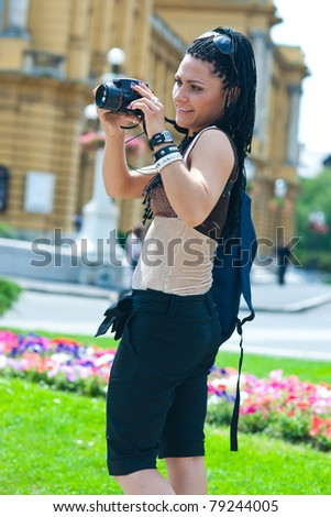 woman tourist looking at camera in old city - stock photo