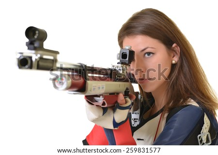 Woman training sport shooting with air rifle gun - stock photo