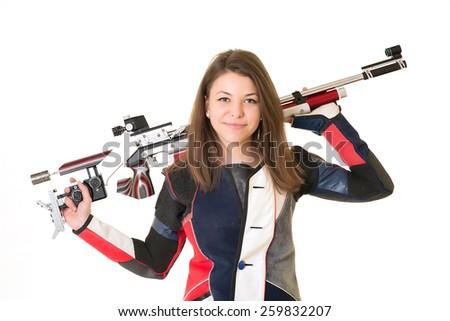 Woman training sport shooting with air rifle gun - stock photo