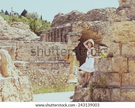 Woman traveler at ancient ruins at Carthage, Tunisia  - stock photo