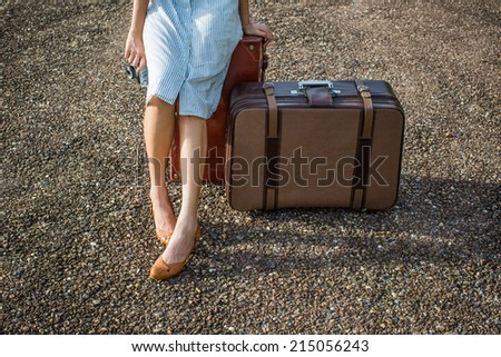 woman traveler with vintage luggage - stock photo