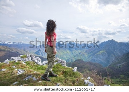 woman trekking at Picos de Europa mountains in Asturias - stock photo