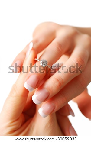 Woman tries on her diamond engagement ring - stock photo