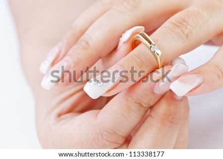 Woman tries on her ring whit stone - stock photo