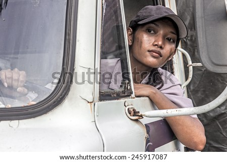woman truck driver in the car - stock photo