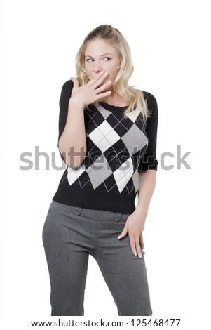 Woman trying to cover her mouth to hide her sarcastic smile - stock photo