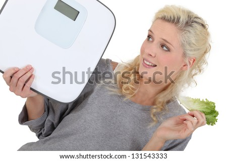 Woman trying to lose weight - stock photo