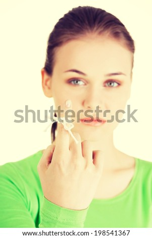 Woman trying to remember what the piece of string round her finger was meant to remind her of - stock photo