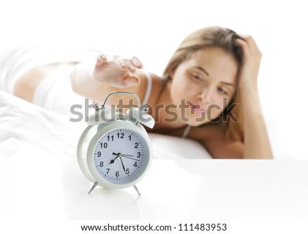 Woman turning off the alarm clock - stock photo