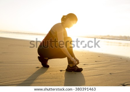 Woman tying her shoes and getting ready for train - stock photo