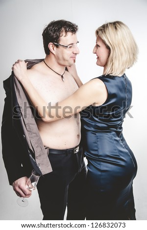 Woman undressing her Friend - stock photo