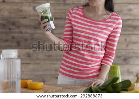 Woman unhappy about the green smoothie - stock photo