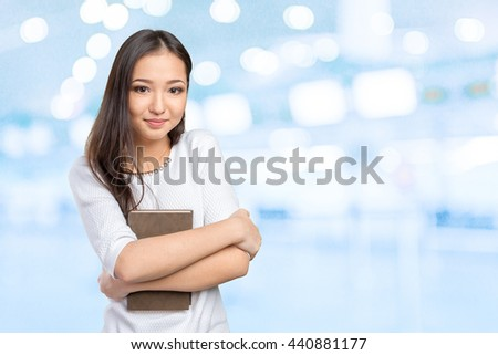 Woman university / college student holding book - stock photo