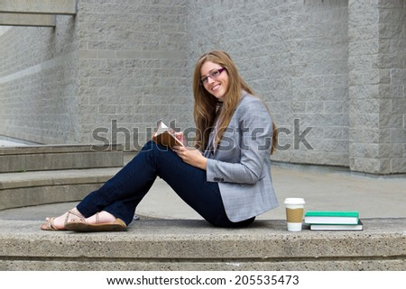 Woman university student studying on campus - stock photo