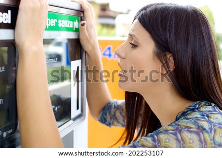 Woman upset about price of gas - stock photo
