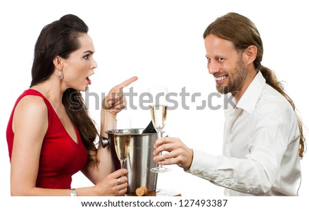 Woman upset with flirting boyfriend when out on a date. Isolated on white. - stock photo