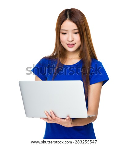 Woman use of laptop computer - stock photo