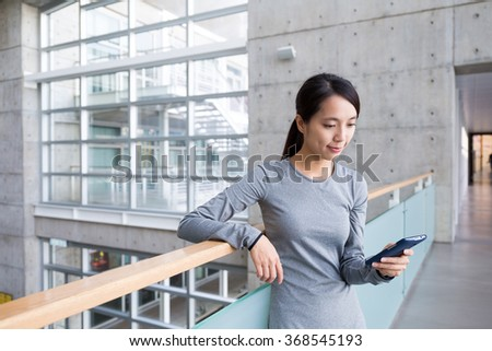 Woman use of the smart phone - stock photo