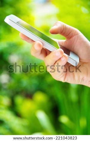 Woman Using a Smart Phone - stock photo