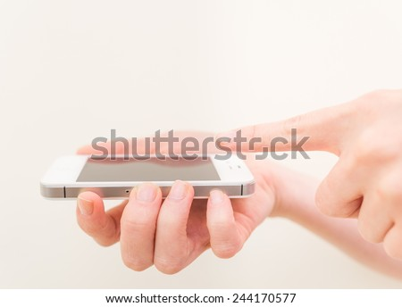 Woman using a smart phone - Close up on woman hands and mobile phone - Concepts about technology and communication - stock photo