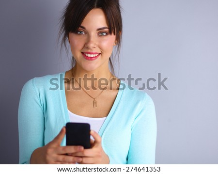 Woman using and reading a smart phone  - stock photo