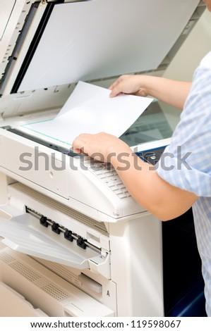 woman using copy machine - stock photo