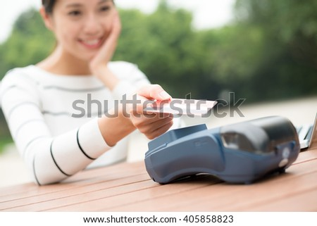 Woman using credit crad to pay - stock photo