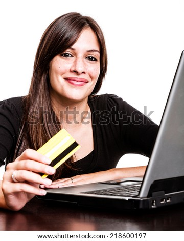 Woman using her credit card for E-commerce - stock photo
