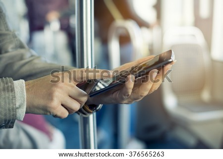 Woman using her mobile phone on bus. Tramway, Sms, message, app - stock photo