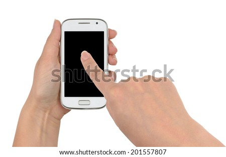 Woman using her smart phone, one hand holding a white smartphone, the other touching its screen with forefinger. Front view, isolated on white background, with clipping paths. - stock photo