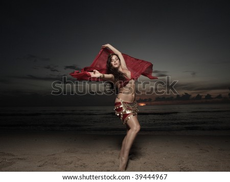 Woman using her veil in a traditional dance - stock photo
