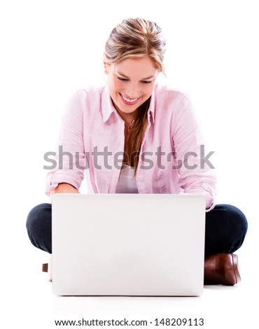 Woman using laptop computer - isolated over a white background  - stock photo