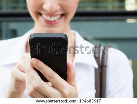 Woman using mobile smart phone. - stock photo
